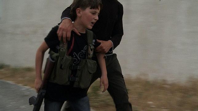20120706210055-joven-soldado-siria-kalashnikov-644x362.jpg